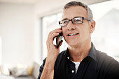 shot mature man talking cellphone at