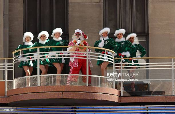 It's Christmas in August as Santa and the Radio City Rockettes kick off the Radio City Christmas Spectacular at on the marquee at Radio City Music...