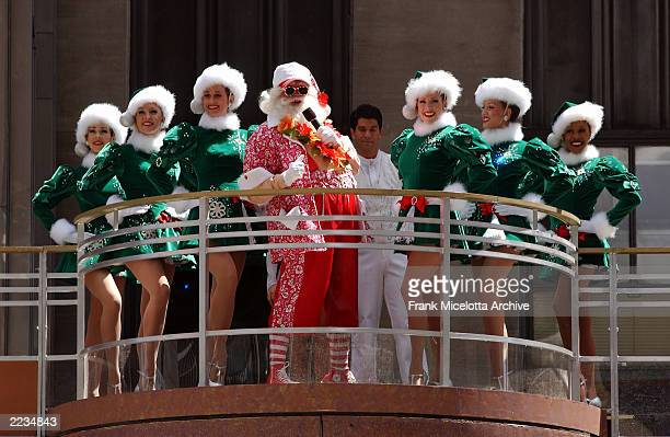 It's Christmas in August as Santa the Radio City Rockettes and ice skaters Jenn and Jeb kick off the Radio City Christmas Spectacular on the marquee...