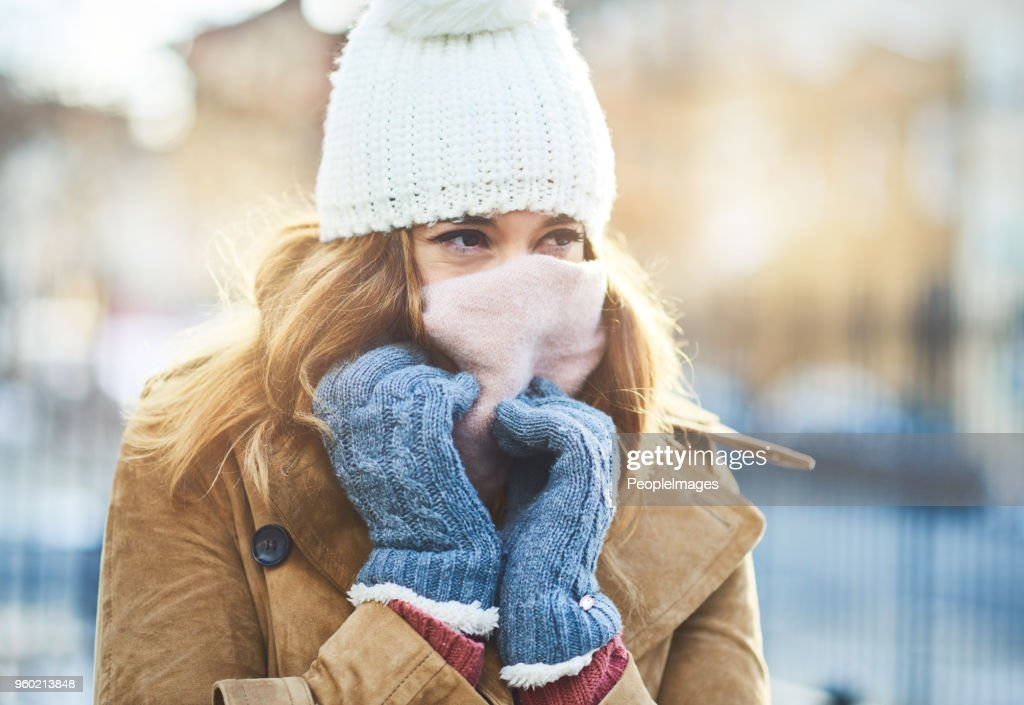 It's cold out here, I have to cover up : Stock Photo