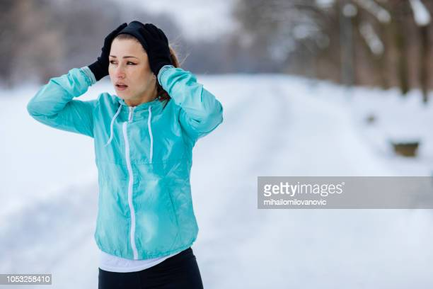 young woman about to start running