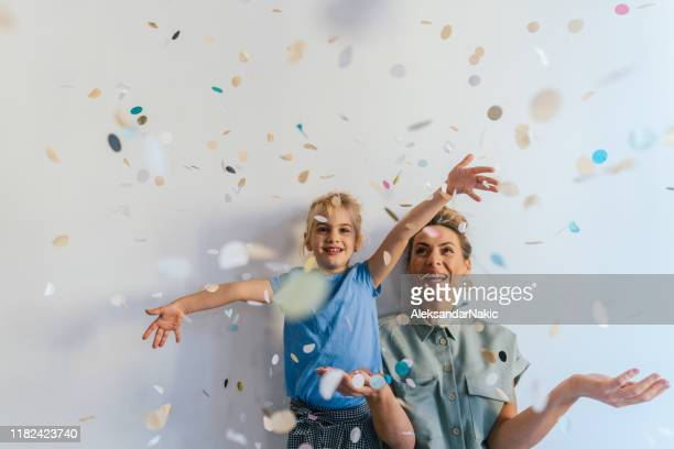 it's confetti time! - photo shoot stock pictures, royalty-free photos & images