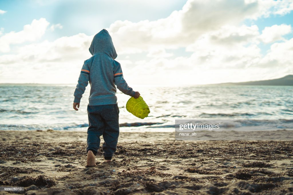 Its fun playing at beach in winter. : Stock Photo