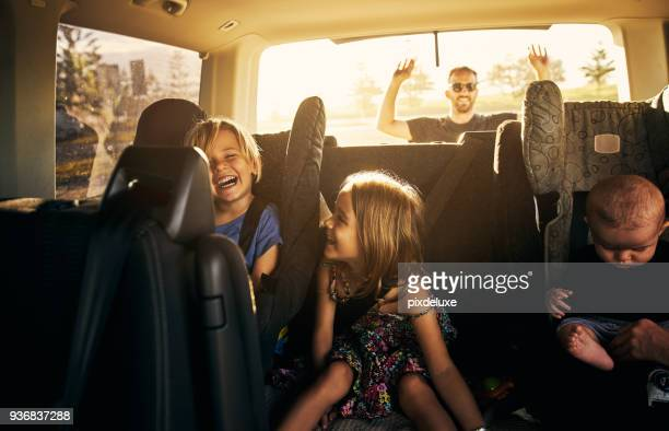it's going to be fun fun fun! - family inside car stock photos and pictures