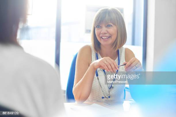 it's good news - female doctor stock photos and pictures