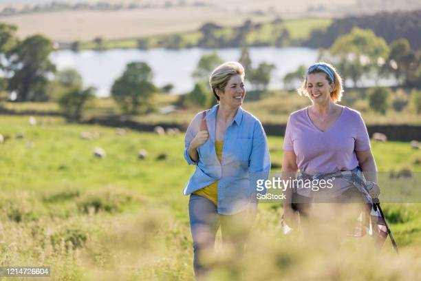 it's good to talk - walking stock pictures, royalty-free photos & images