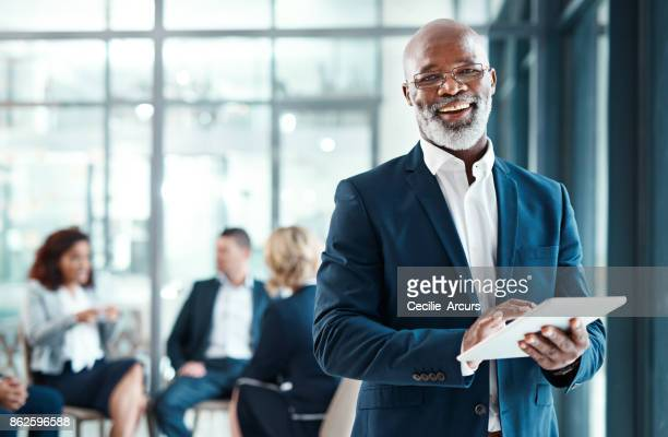 it's got all of my ceo duties covered - african ethnicity stock pictures, royalty-free photos & images