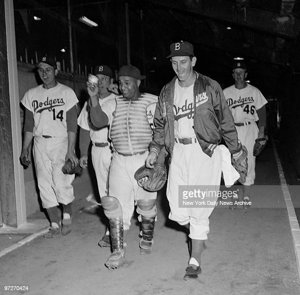 It's Great to be a Winner Dodger catcher Roy Campanella heading for clubhouse holds aloft ball he planted on Billy Martin to register final out of...
