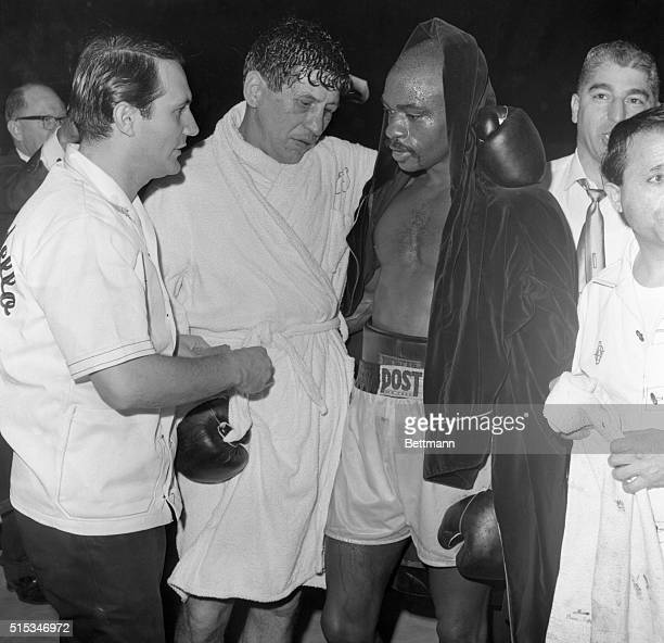 It's hard to tell by the expressions on their faces but Joey Giardello and Rubin Carter are waiting for the official verdict Ring officials gave...