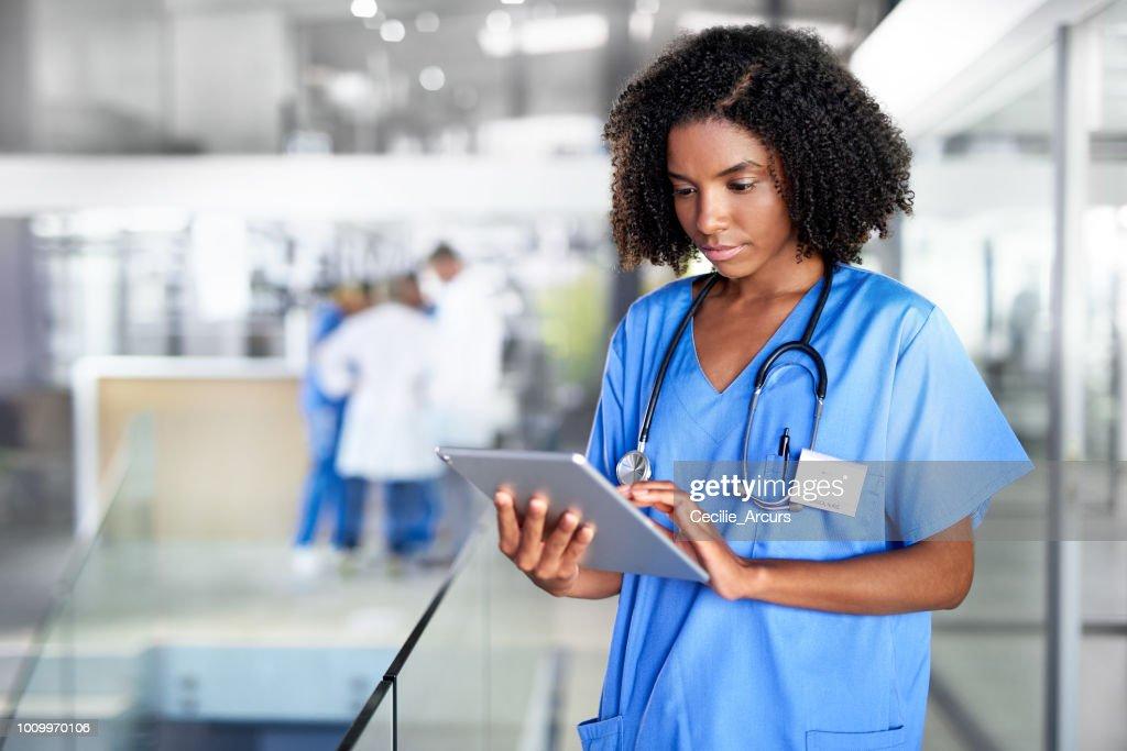 It's her digital medical encyclopedia : Stock Photo