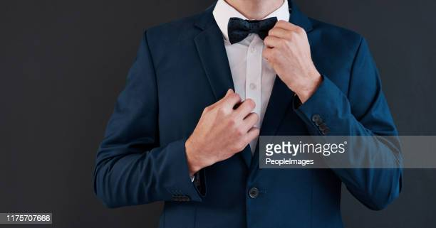 it's his day, he's gotta have the best tie - adjusting necktie stock pictures, royalty-free photos & images