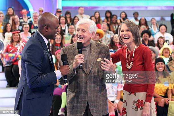 It's host Wayne Brady legendary host Monty Hall and model Carol Merrill and they all share a moment together on a special 50th anniversary episode of...