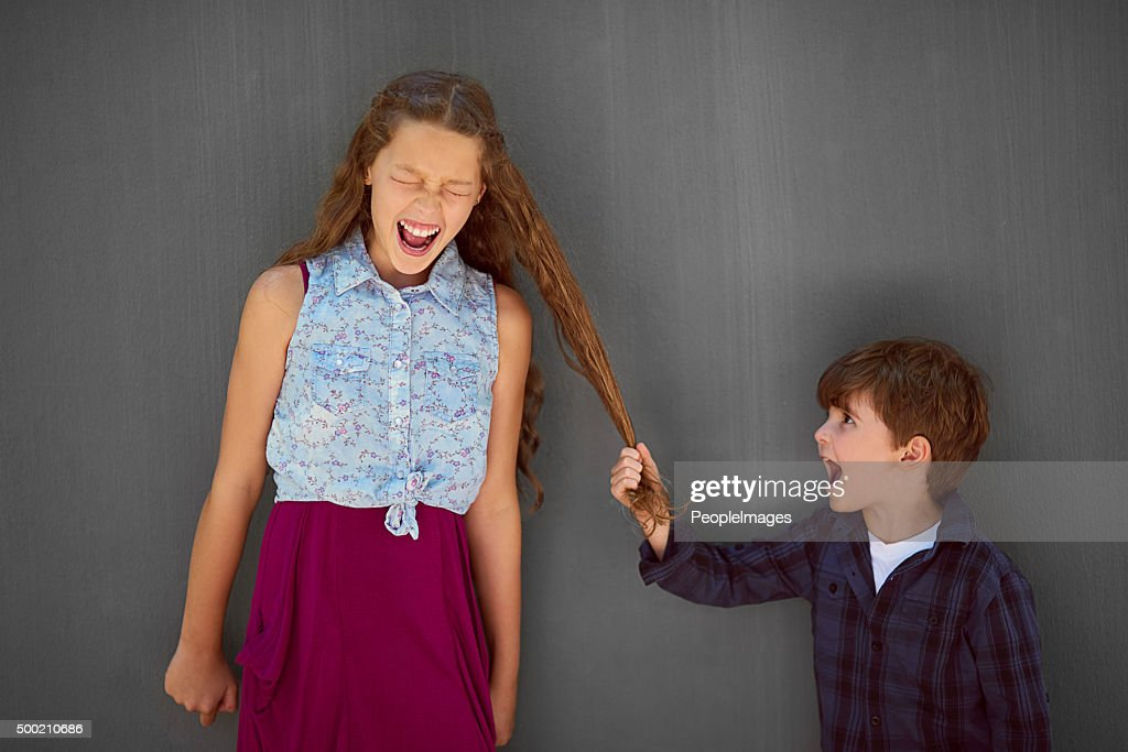 It's just what little brothers do : Stock Photo
