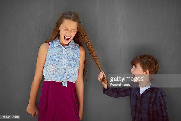 it's just what little brothers do - sister stock pictures, royalty-free photos & images