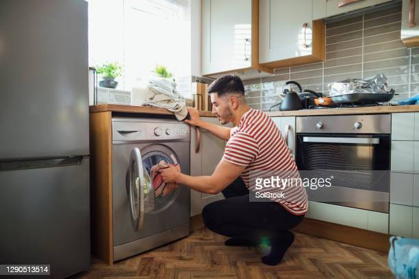 it's laundry day! - washing machine stock pictures, royalty-free photos & images