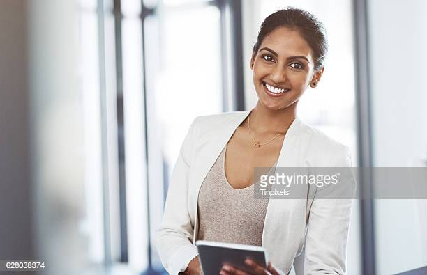 it's loaded with apps to suit my business interests - indian woman stock photos and pictures