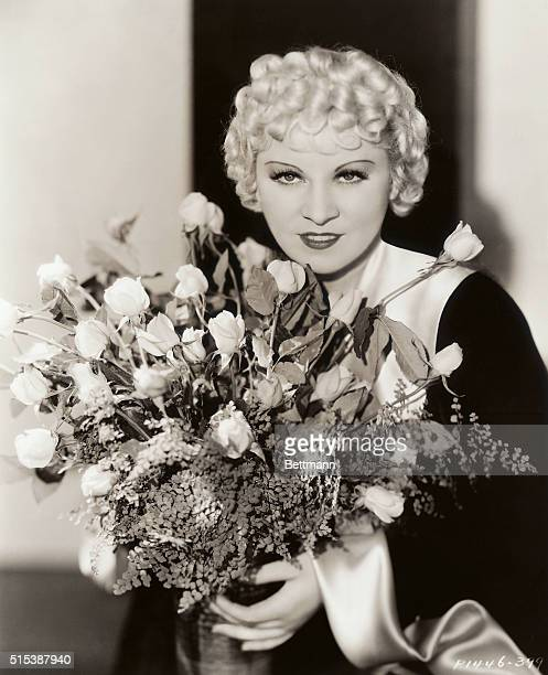 """It's Mae Day, and Mae West celebrates with Mae flowers on May 1st. The blonde Mae is offering the nation a """"Mae Day"""" present for her latest Paramount..."""