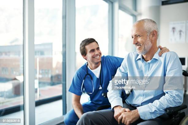 it's my job to keep you happy and well - male doctor stock photos and pictures