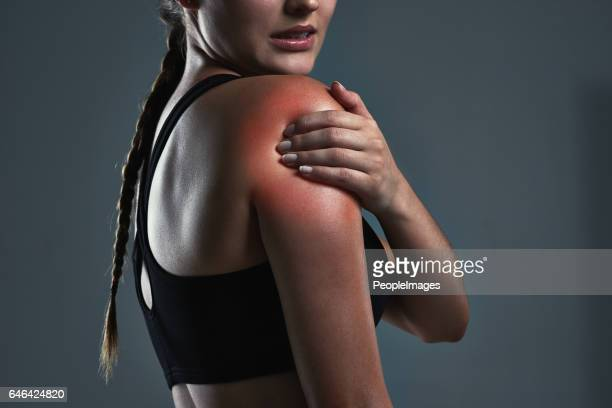 it's never a good idea to workout with cold muscles - shoulder stock pictures, royalty-free photos & images