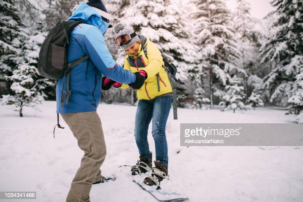 it's never too late for snowboarding lessons - winter sport stock pictures, royalty-free photos & images