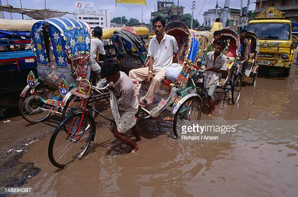 It's not easy getting a rickshaw through the streets of monsoon flooded Dhaka