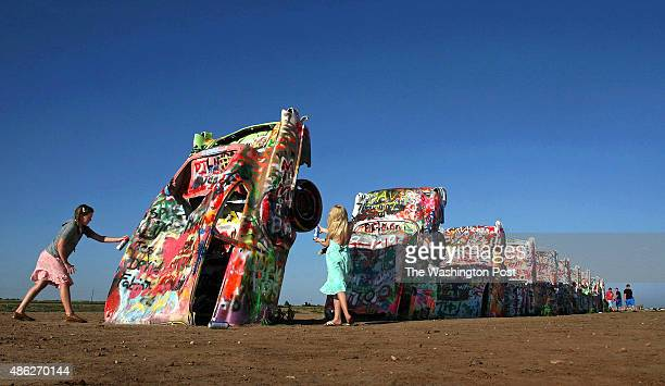 It's OK to add one's own artistic mark at the famed Cadillac Ranch Wikipedia describes the landmark 'Cadillac Ranch is a public art installation and...
