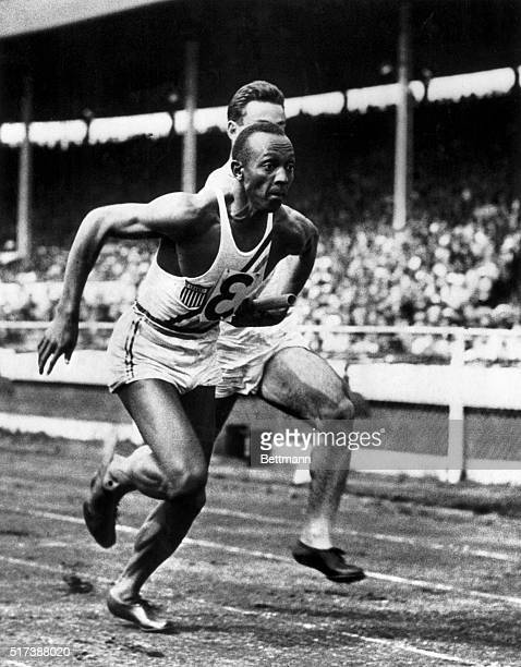 It's Owens again London England Jesse Owens fresh from his triumphs in the Olympics is shown taking over the baton from MI Glickman in the 400 yard...