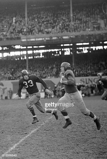 It's Sam Baugh Redskin halfback coming in for a tackle after Bill Paschal New York Giant fullback carried the ball for 35 yards The Giants won the...