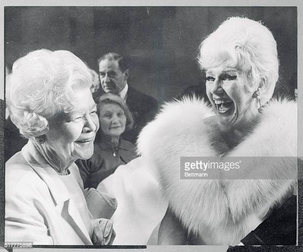It's smiles all around as actress Ginger Rogers is congratulated by her mother Lela Rogers left backstage at the Theatre Royal late February 20th...