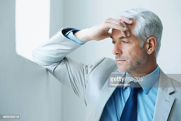 it's stressful at the top - handsome 50 year old men stock photos and pictures