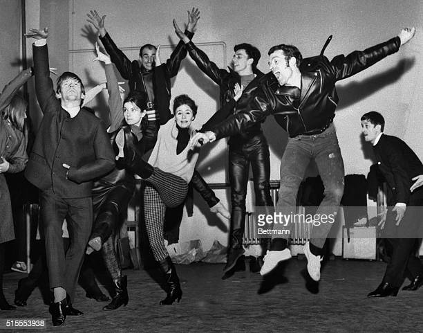 It's sweeping the countrythe Beatle Beat that is and the country is Great Britain This arm flinging high kicking group is performing a ballet routine...