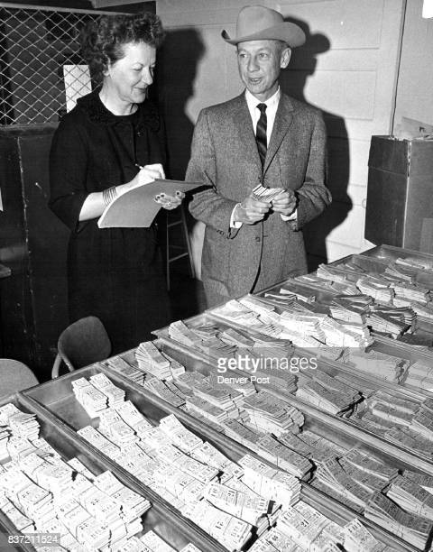 It's That Time Again Mrs Del Patton 3604 Forest St and Willard Simms general manager of 1966 National Western Stock Show look over some of the 150000...