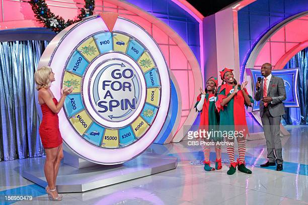 It's the game Go for a Spin for both Kisha Franklin and Alexandria Simmons of Los Angeles as Model Tiffany Coyne and Host Wayne Brady watch on a...