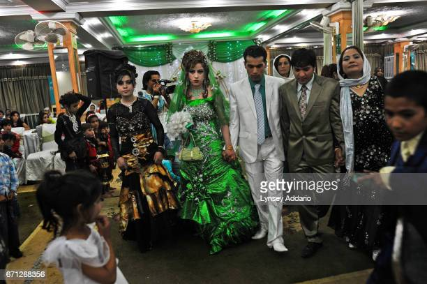 It's very delicate to photograph an Afghan wedding The women are unveiled and often wear revealing dresses and heavy makeup They are reluctant to...