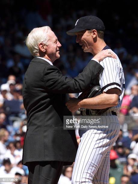 It's Whitey Ford Day and the great New York Yankees' pitcher says an encouraging word to pitcher David Cone on the mound before the game at Yankee...