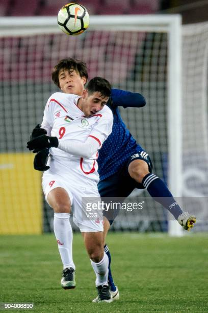Itsuki Urata of Japan and Oday Dabbagh of Palestine compete for the ball during the AFC U23 Championship Group B match between Japan and Palestine at...