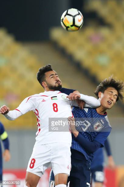 Itsuki Urata of Japan and Omar Sandouqa of Palestine compete for the ball during the AFC U23 Championship Group B match between Japan and Palestine...