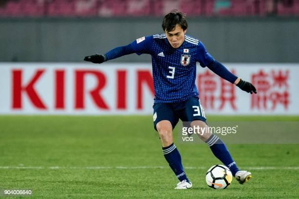 Itsuki Urata of Japan drives the ball during the AFC U-23 Championship Group B match between Japan and Palestine at Jiangyin Sports Center at...