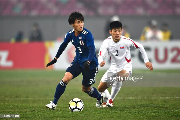 Itsuki Urata of Japan drives the ball during the AFC U-23 Championship Group B match between Japan and North Korea at Jiangyin Stadium on January 16,...