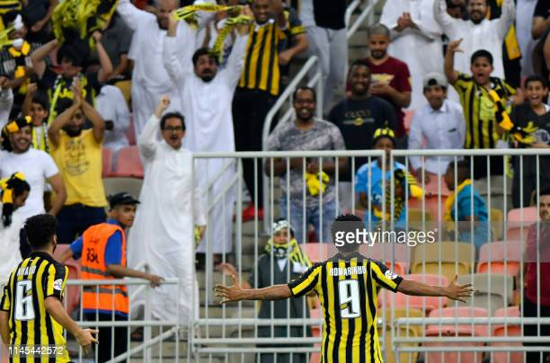 Ittihad's forward Romarinho celebrates his goal during the AFC Champions League group B football match between Saudi's Al Ittihad and UAE's Al Wahda...