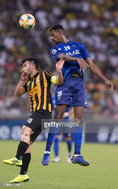 Ittihad's midfielder Carlos Villanueva vies for the ball with Hilal's midfielder Mohamed Kanno during the AFC Champions League quarter-finals...