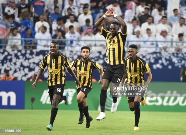 Ittihad's players celebrate after scoring a goal during the AFC Champions League quarter-finals football match between Saudi Arabia's Al-Ittihad and...