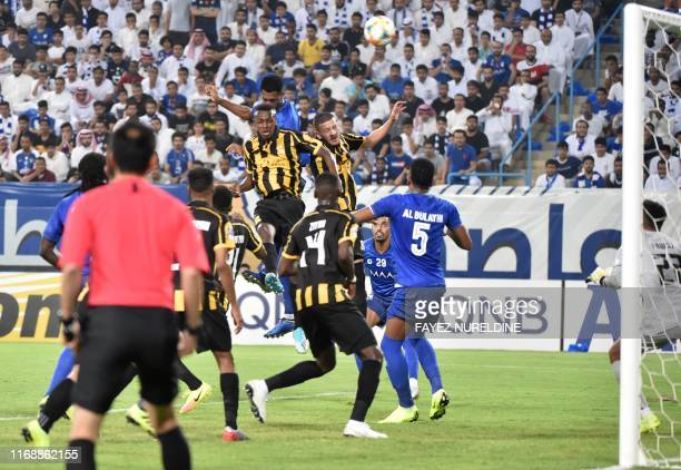 Ittihad's players vies for the ball with Hilal's players during the AFC Champions League quarter-finals football match between Saudi Arabia's...