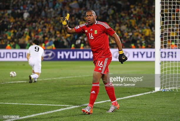 Itumeleng Khune objects as he is sent off with a red card following a challenge on Luis Suarez of Uruguay during the 2010 FIFA World Cup South Africa...
