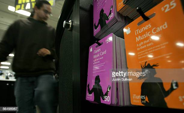 iTunes song gift cards are seen on display at a Best Buy store December 29 2005 in San Francisco California Retailers experience a rise in gift card...