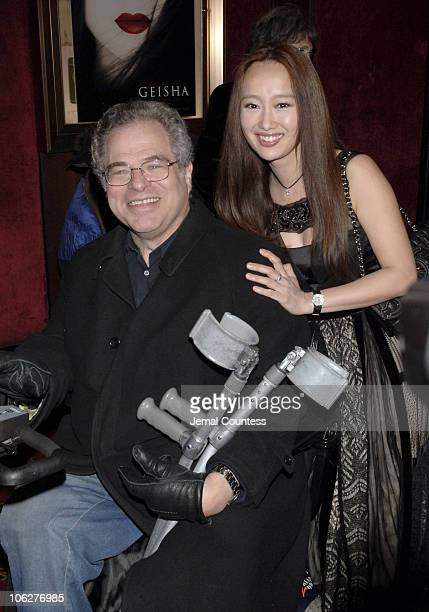 Itzhak Perlman and Youki Kodoh during 'Memoirs of a Geisha' New York City Premiere Inside Arrivals at Ziegfeld Theater in New York City New York...
