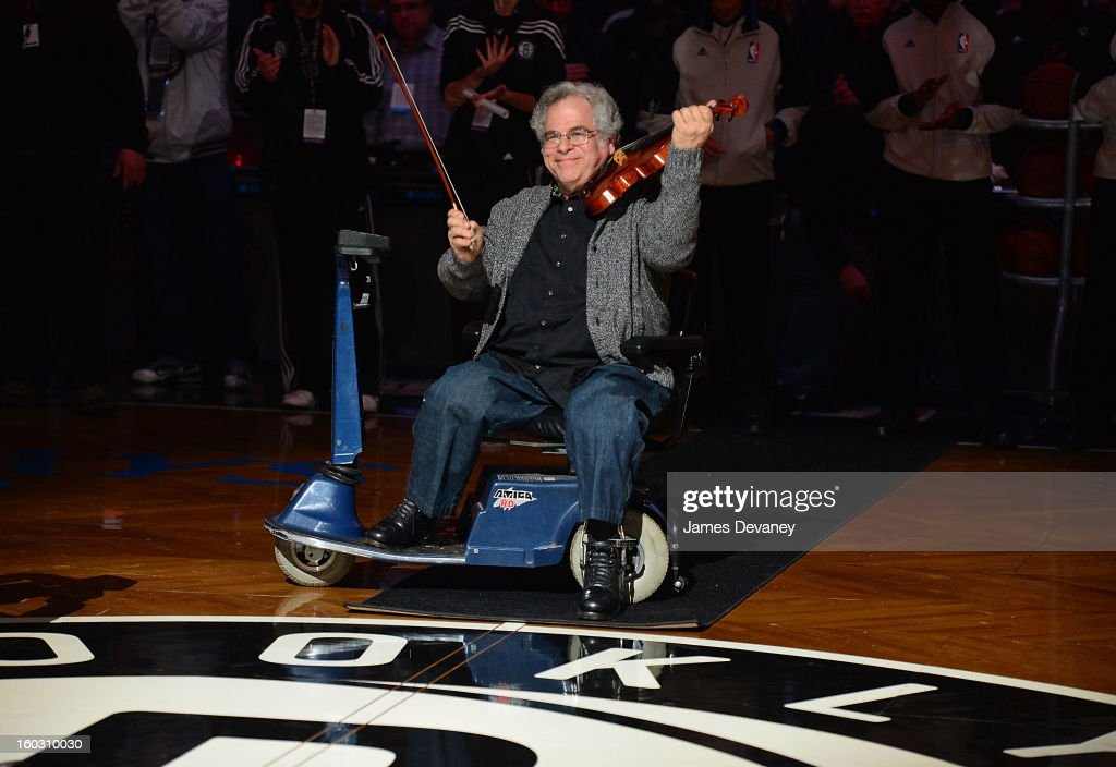 Itzhak Perlman performs 'The Star-Spangled Banner' before the Orlando Magic vs Brooklyn Nets game at Barclays Center on January 28, 2013 in the Brooklyn borough of New York City.