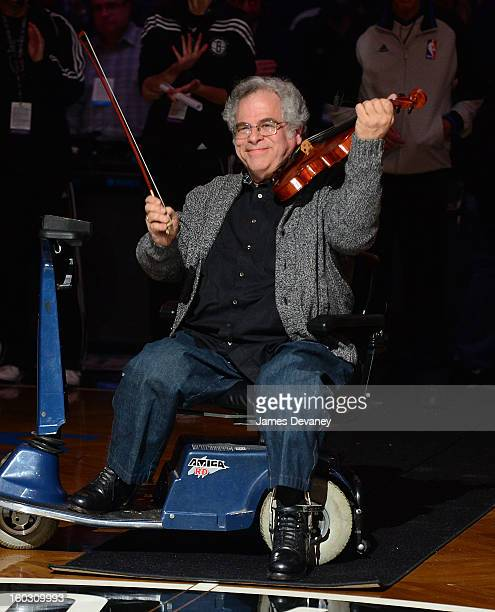 Itzhak Perlman performs 'The StarSpangled Banner'before the Orlando Magic vs Brooklyn Nets game at Barclays Center on January 28 2013 in the Brooklyn...