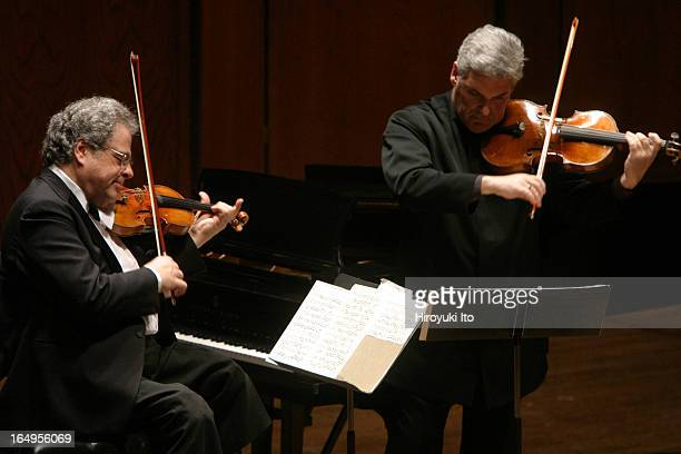 Itzhak Perlman Pinchas Zukerman performing together at Avery Fisher Hall on Tuesday night April 25 2006This imageFrom left Itzhak Perlman and Pinchas...