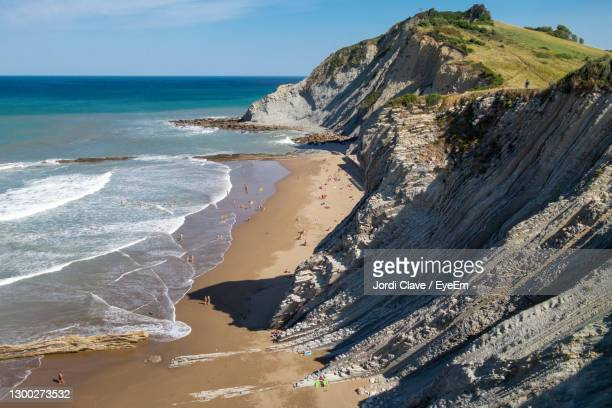 itzurun beach in zumaia, flysch geological coast in the basque country, spain - ギプスコア ストックフォトと画像